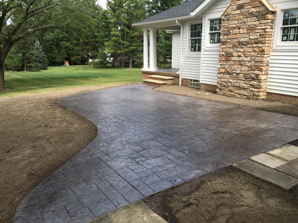 Stamped Concrete Patio with cultured stone fireplace.