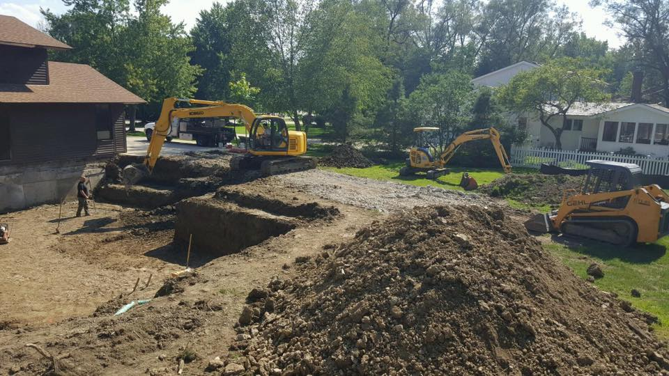 Excavating for a new foundation on the back of an existing home.