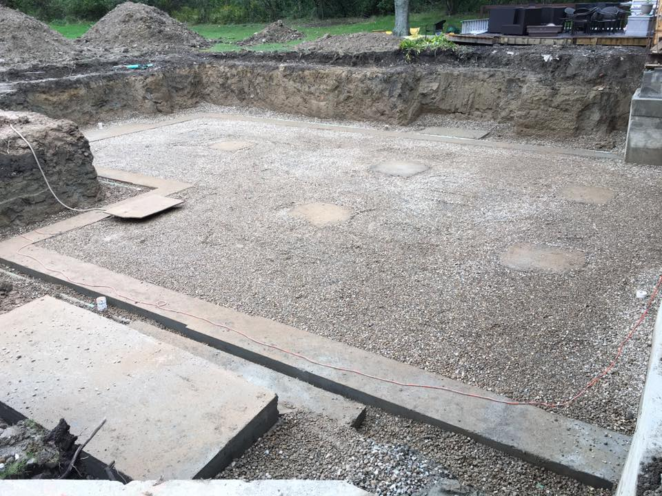 Footers, drain tile and gravel in place for a new basement foundation.
