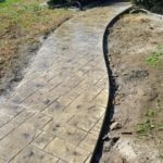 Stamped concrete walkway with integral and antique color.