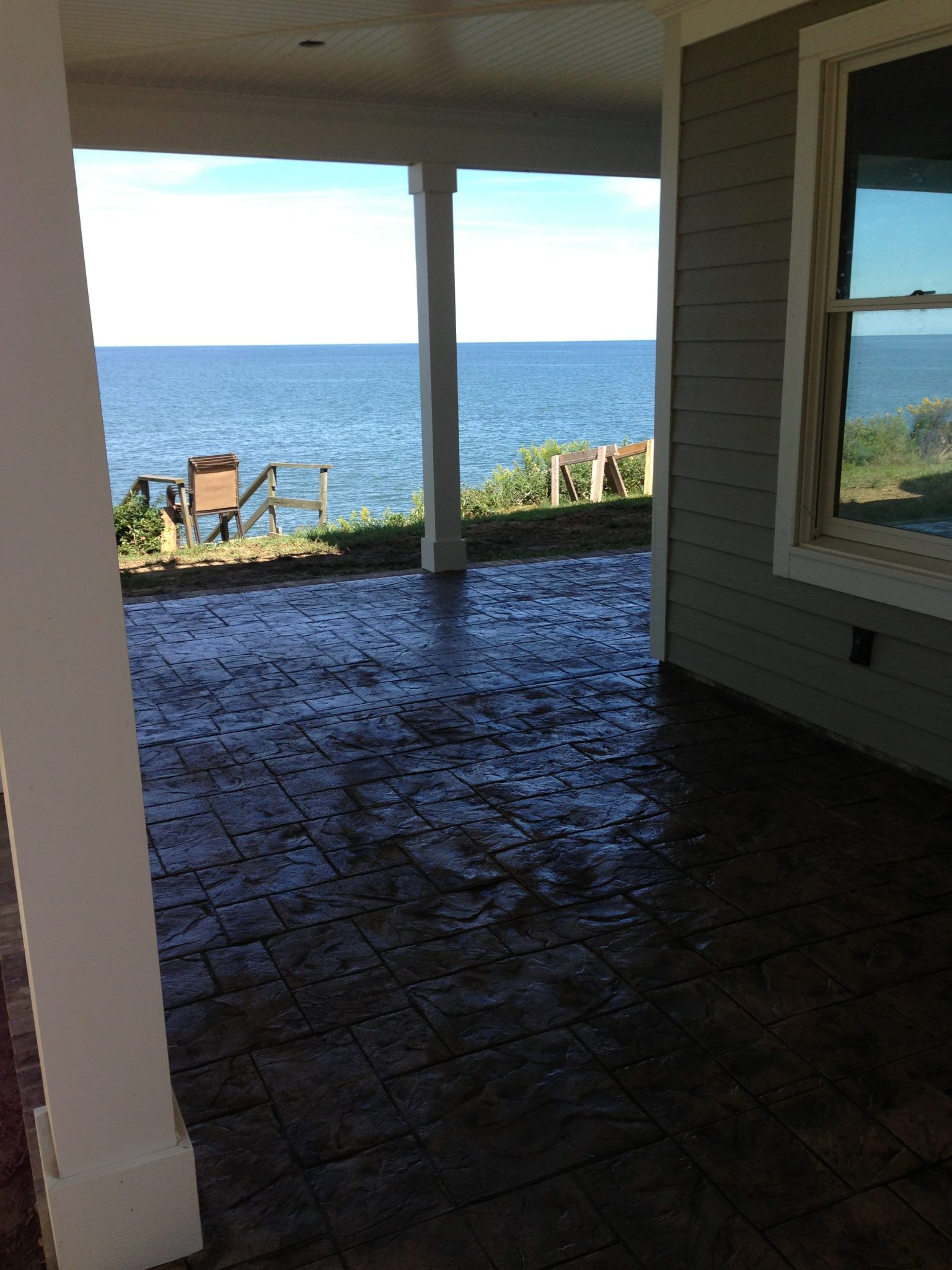 Stamped ashlar slate porches at a lake house in Madison, Ohio.