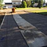 Concrete driveway with rebar reinforcement.