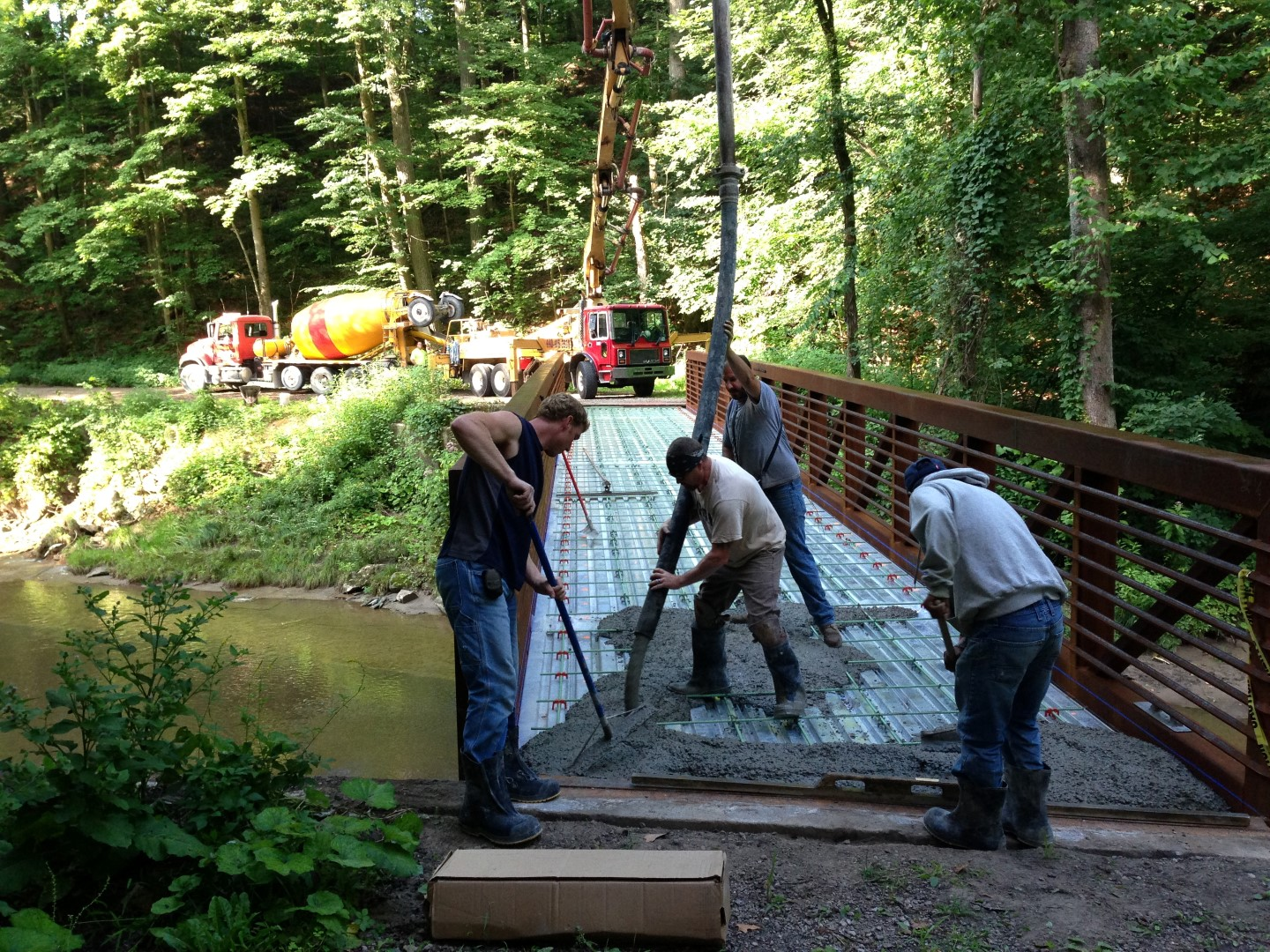 Paving a bridge deck with concrete.