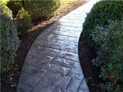 Ashlar slate stamped concrete walkway.