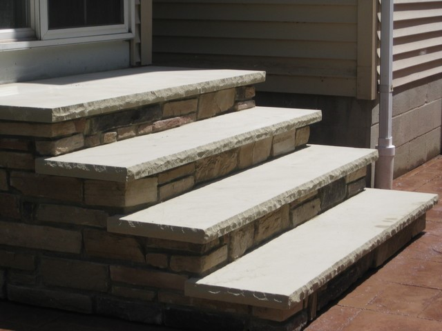 Cultured stone masonry steps with limestone threads