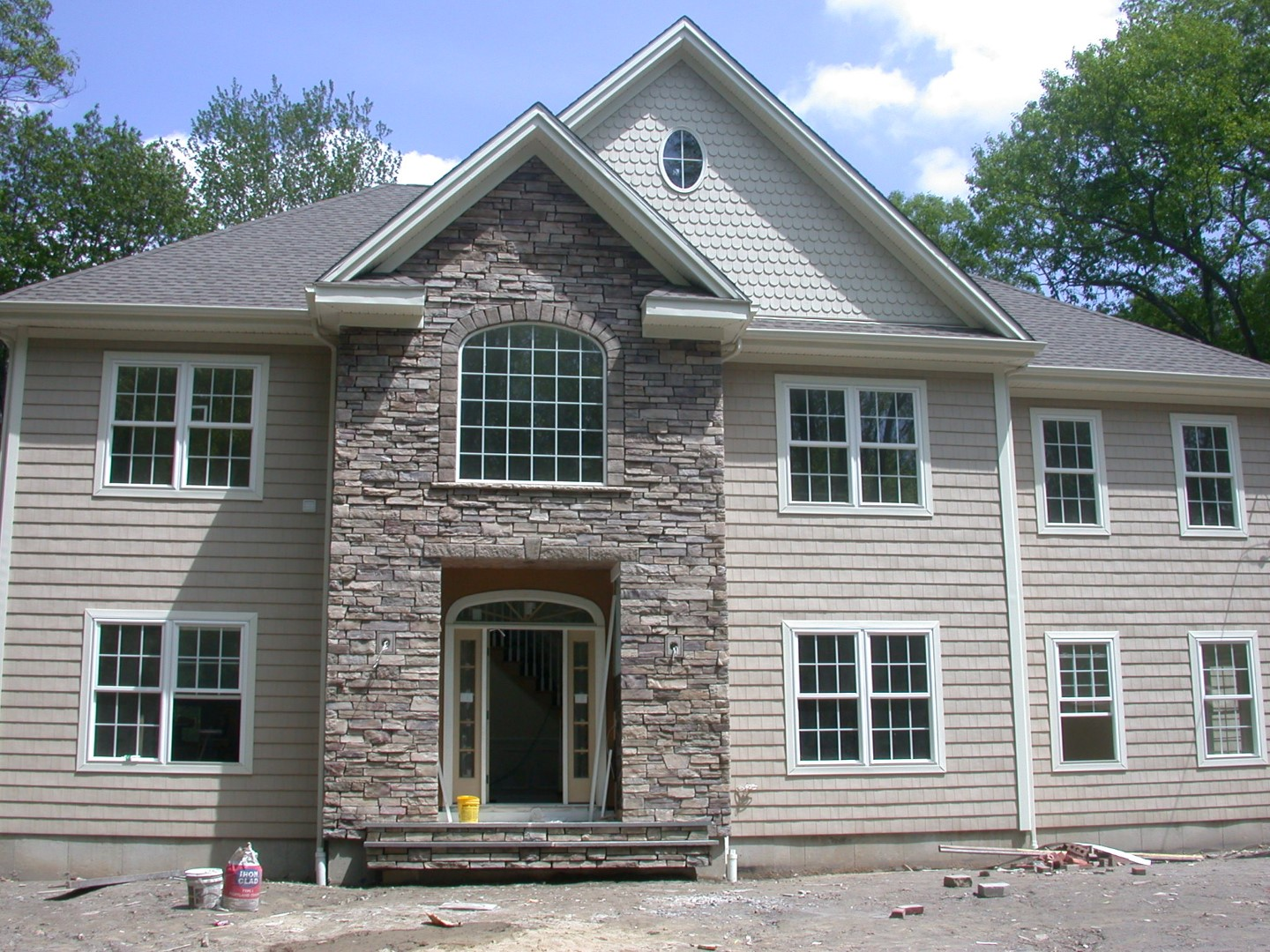 Cultured stone masonry for the front of a new home.