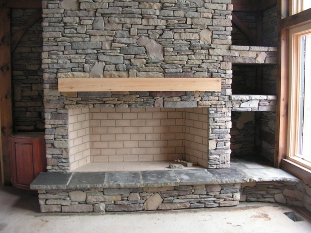 Cultured stone fireplace with hearth in Gates Mills Ohio