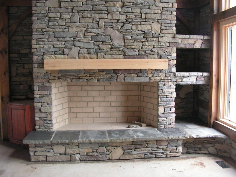 Cultured stone masonry fireplace in Mentor, Ohio