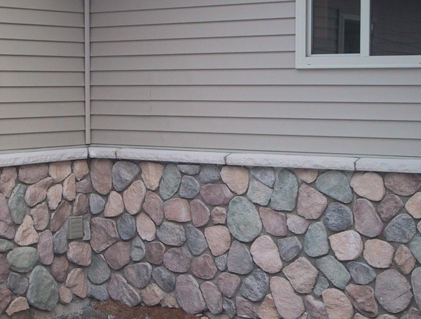 Cultured Stone veneer with limestone ledge.