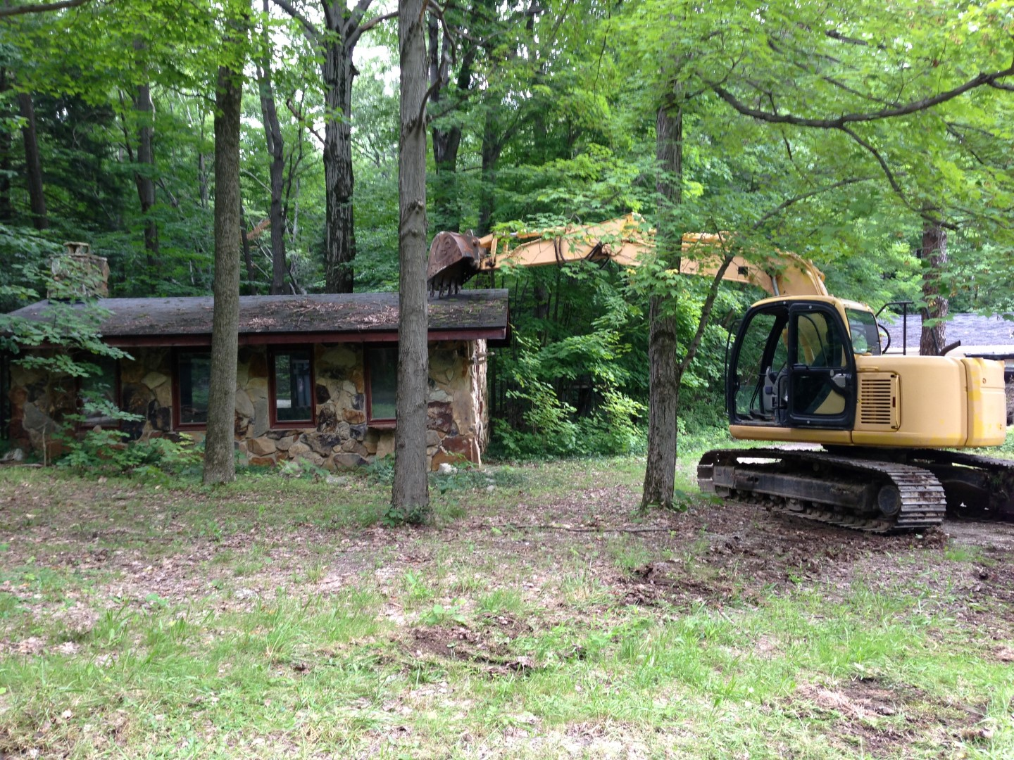 Home demolition in Thompson Ohio 44086