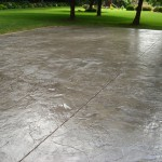 Seamless Stamped concrete driveway with high gloss sealer.