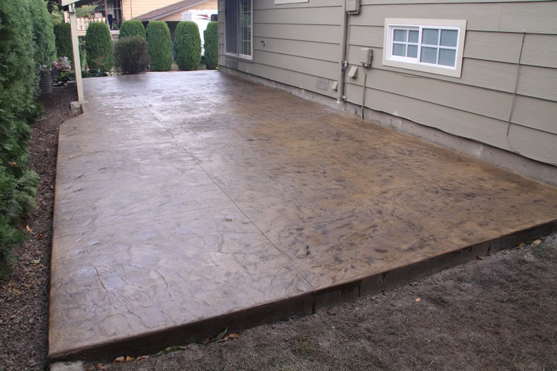 Stamped concrete patio with integral and antique color.