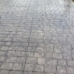 london Cobblestone patio in stamped concrete.