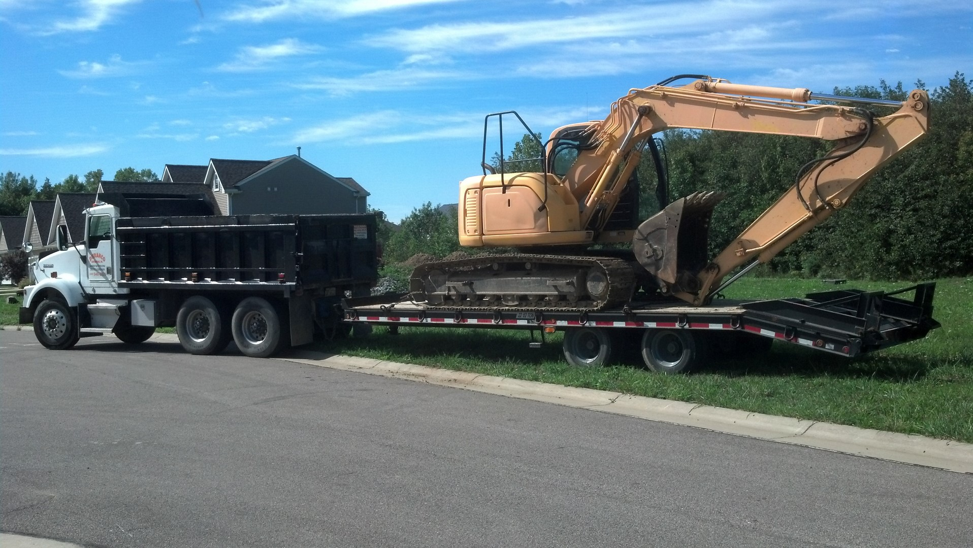Hauling an excavator to a excavation site.