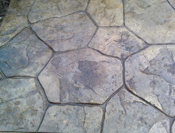 Random stone stamped concrete patio.