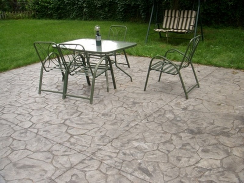 Stone pattern stamped concrete patio.