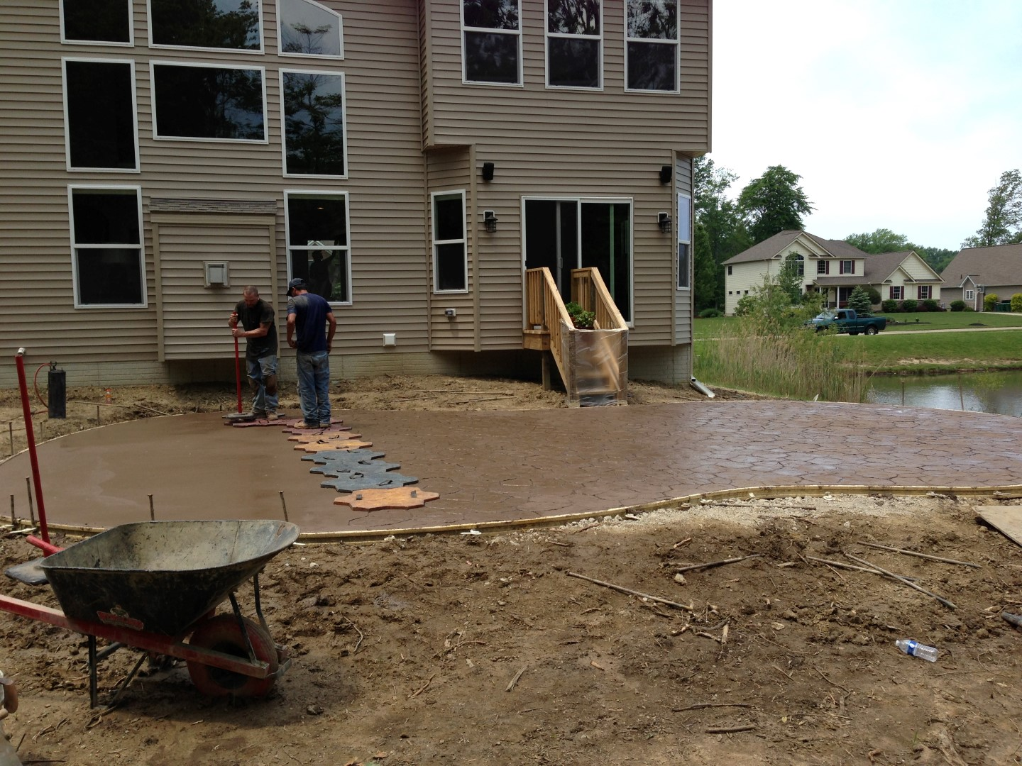 The stamping process of a stamped concrete patio.