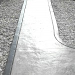 Stamped Concrete walkway in seamless pattern with border.