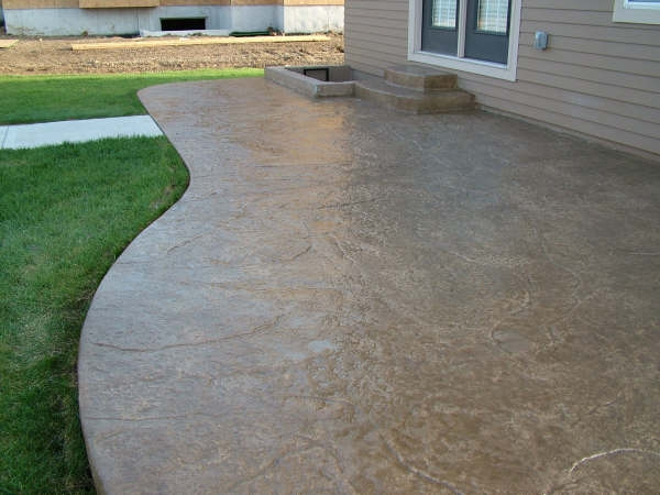 Seamless stamped concrete with integral step.
