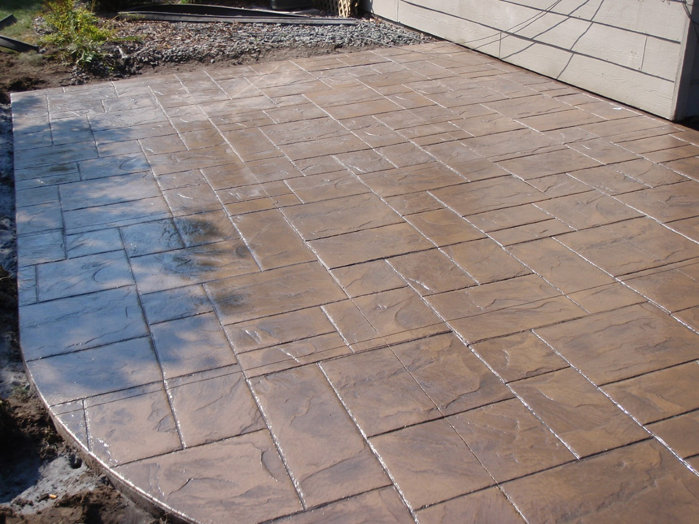 Ashlar slate stamped concrete patio.