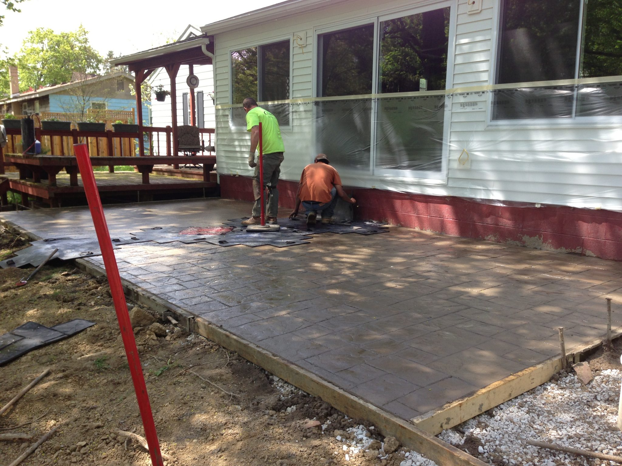 Stamping a concrete patio.