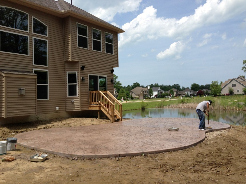 Sealing of a new construction stamped concrete patio.