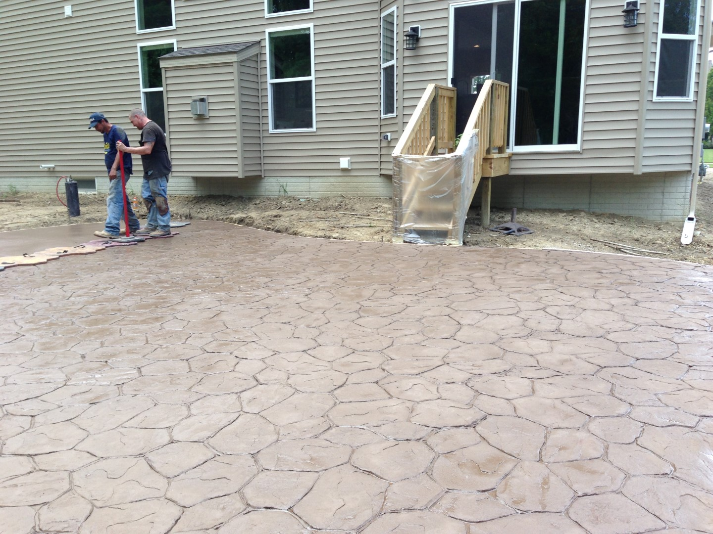Placement of a stamped concrete with random stone pattern. Solon Ohio