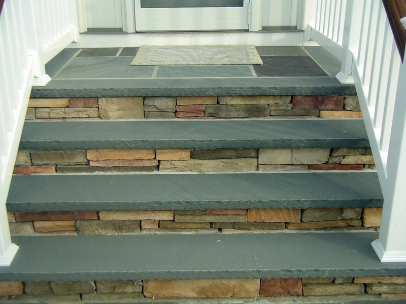 Replacement of steps with cultured stone.