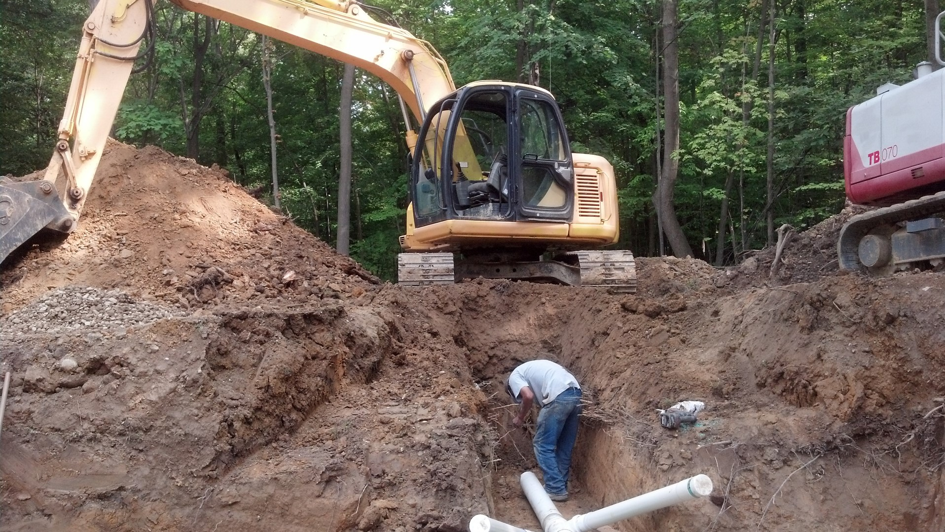 Excavation of a storm sewer lateral line.