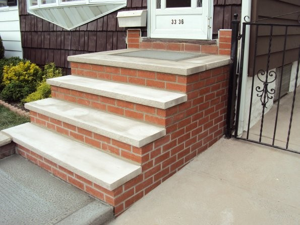 Replacement of steps with brick masonry and limestone threads.