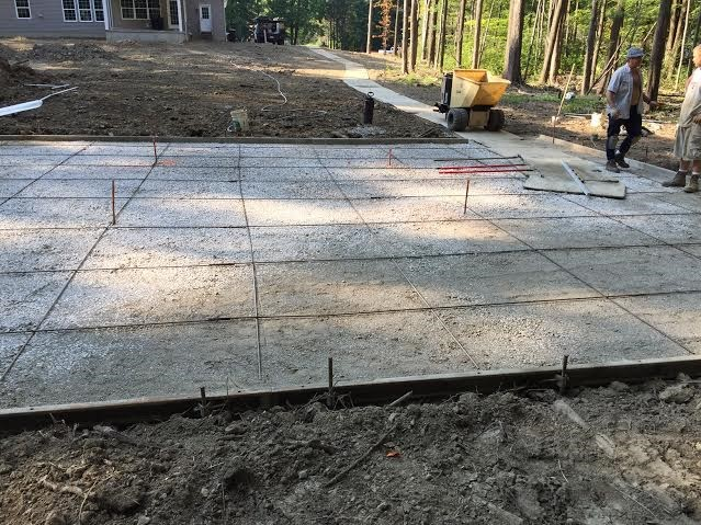 Concrete basketball pad.