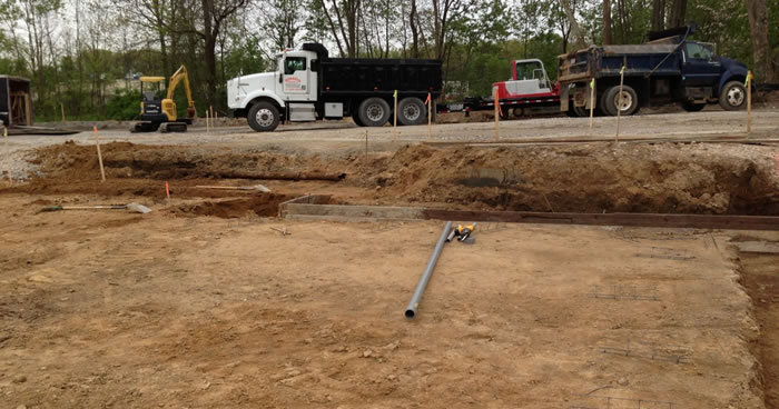 Grading and excavating for a new foundation