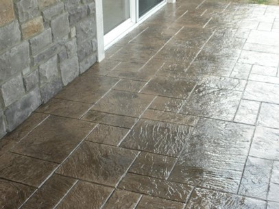 Ashlar slate stamped concrete with cultured stone