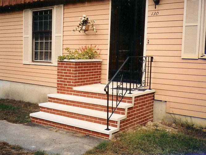 Masonry repair service. Replacement of a front masonry step.