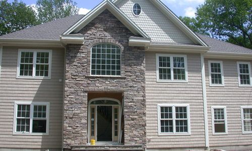 cultured stone on the front of a new home