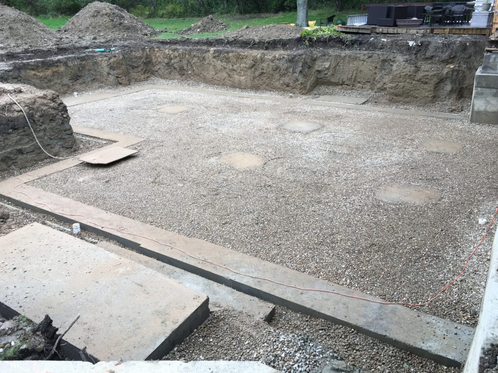 Footers poured with drain tile and gravel