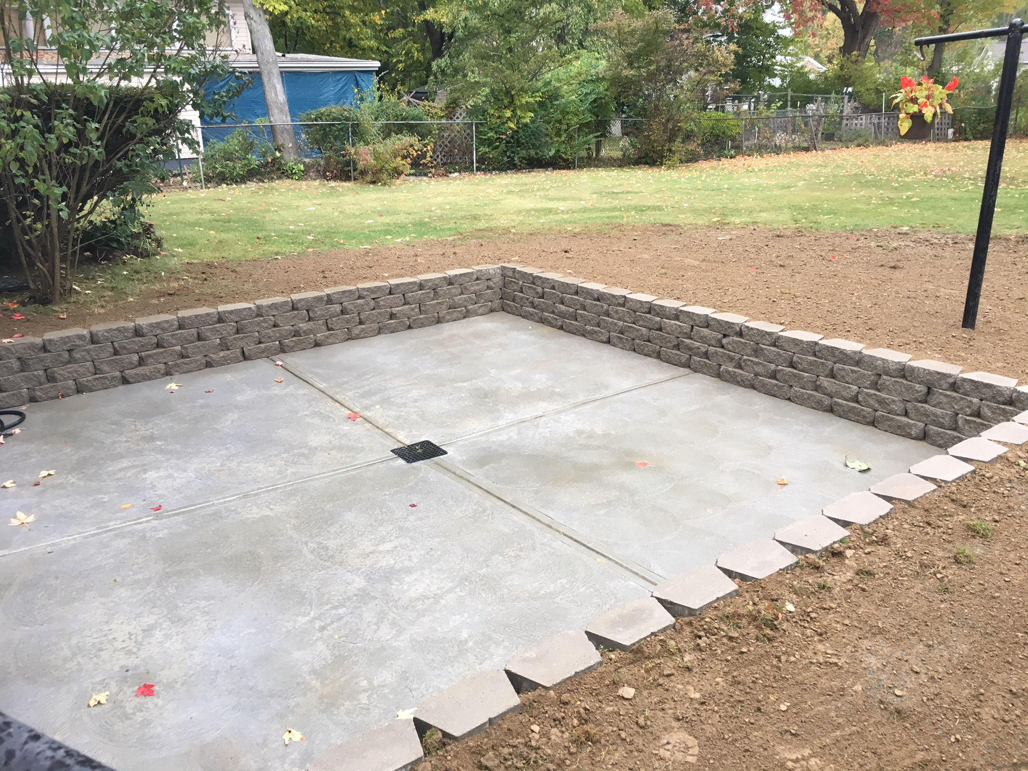 concrete patio with a retaining wall