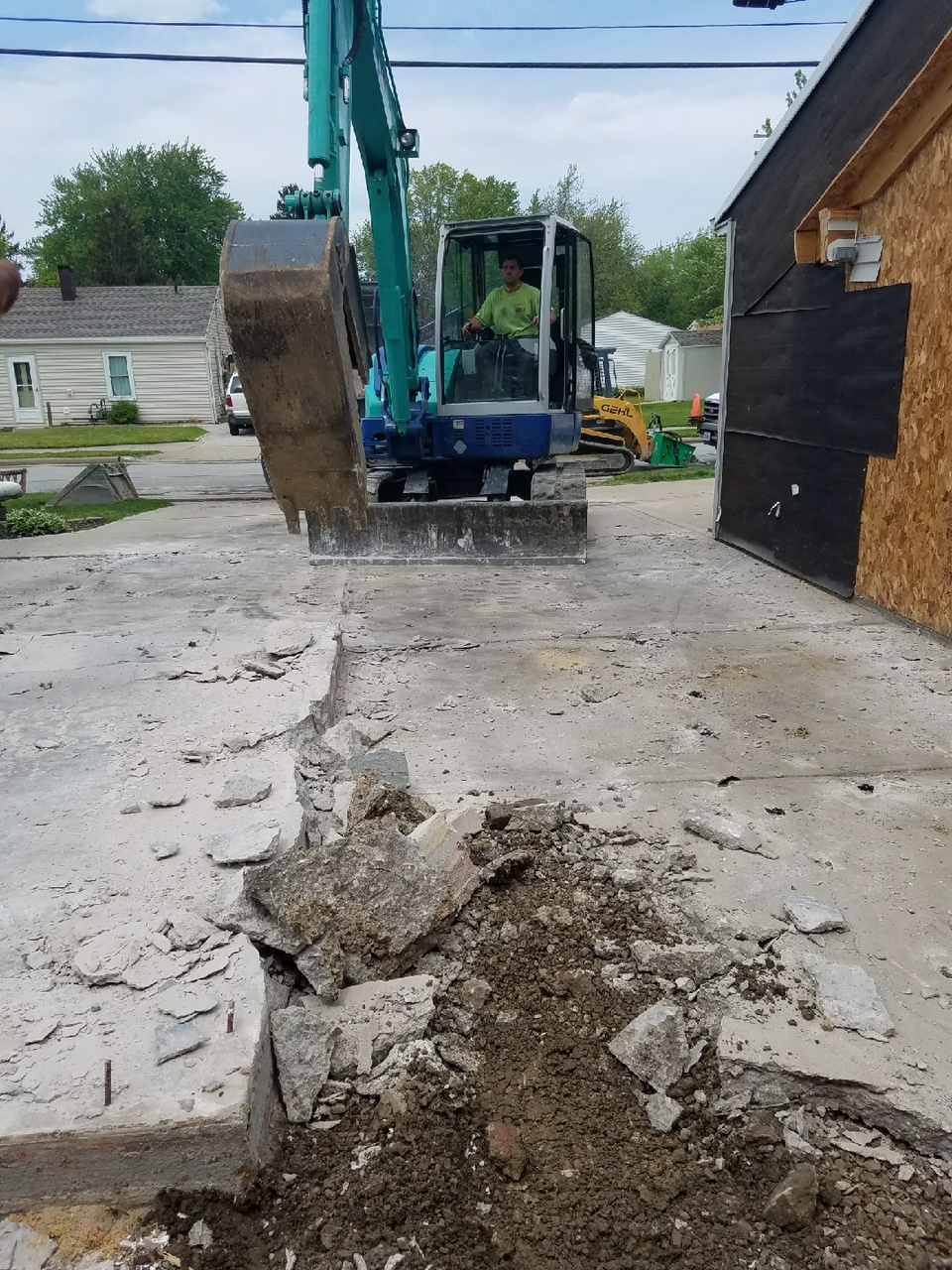 Concrete removal for a new concrete slab addition