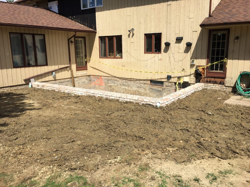Crawl space foundation with brick to grade in Beachwood, Ohio