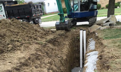 Sewer repair of a storm sewer and sanitary sewer lateral line